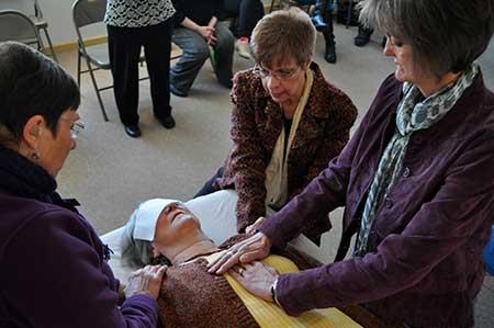 Lourdes Gray teaching Reiki 2  students